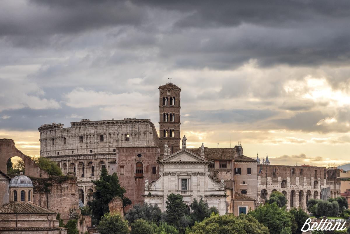 Basilica of Santa Francesca Romana and Coliseum at sunrise ROME
