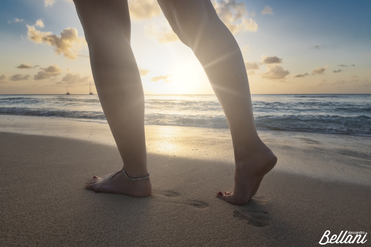 The legs of woman during sunset BARBADOS ISLAND