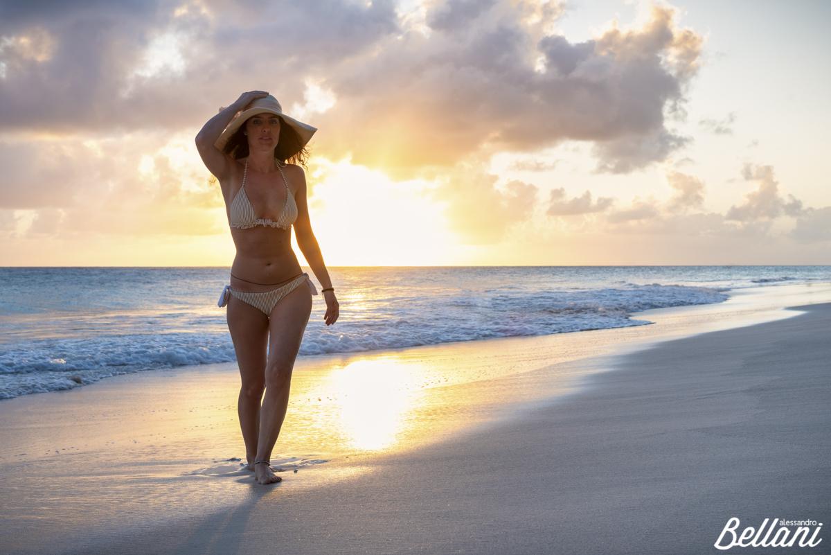 Woman walks on the waterfront of Miami Beach BARBADOS ISLAND