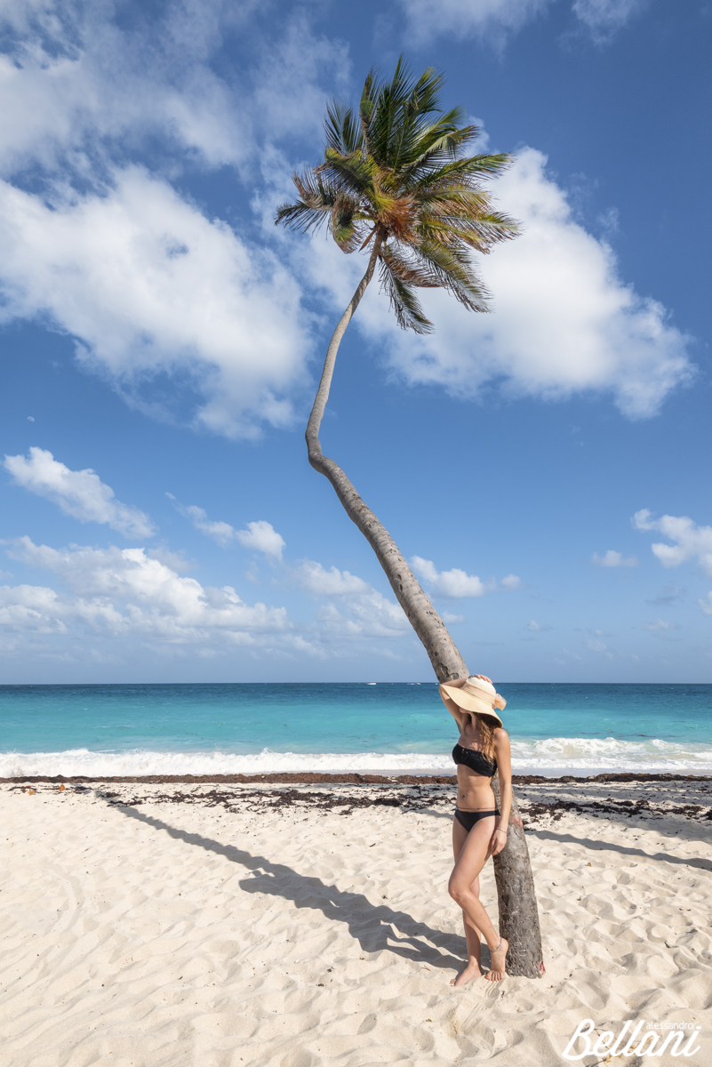 Woman with hat have relax under the palm tree BARBADOS ISLAND